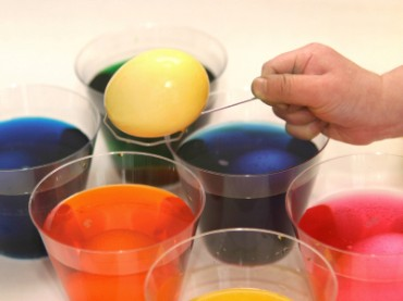 Coloring Easter Eggs in Plastic Cups with Dye