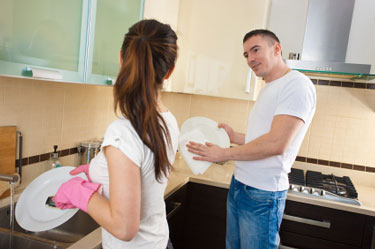 Husband and Wife Washing Dishes