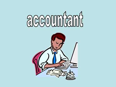 An Accountant Sitting at His Desk