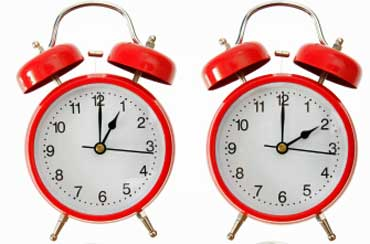 Two Red Alarm Clocks - 1:00 and 2:00