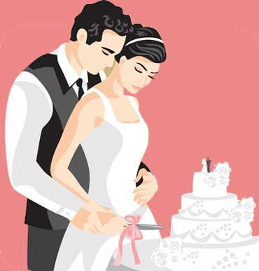 A Couple Cuts the Wedding Cake