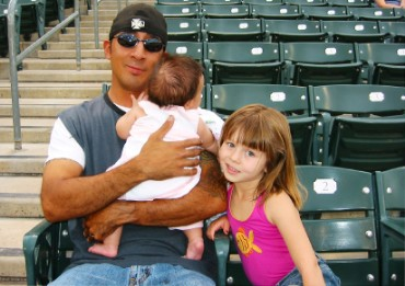 Father, Daughter, and Baby at Baseball Game