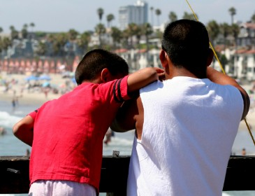 Father and Son Fishing at Oceanside Pier in California
