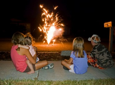 Kids Watching Fireworks on the Street