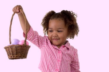 Girl Holding an Easter Basket Filled with Pink and Purple Eggs