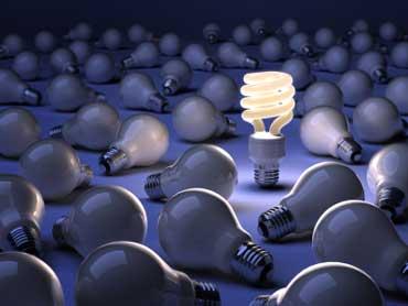 An Energy-Saving Fluorescent Light Bulb Among Incandescent Light Bulbs