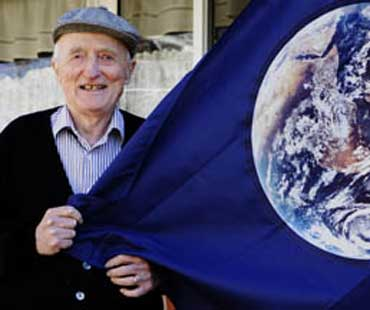 John McConnell with Earth Day Flag