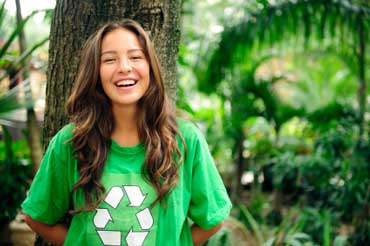 Woman Wearing a T-shirt with a Recycle Symbol