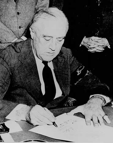 FDR Signs War Declaration Against Japan
