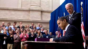 President Barack Obama Signs Bill as Vice President Joe Biden Observes