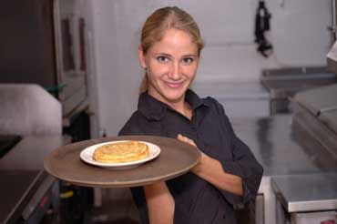 Waitress Serving Pancakes