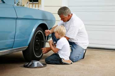 Dad and Son Changing a Tire