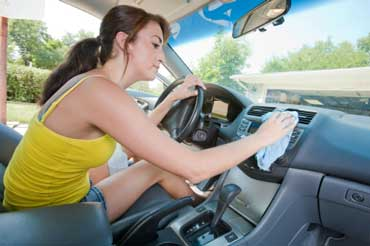 Woman Cleaning the Dashboard