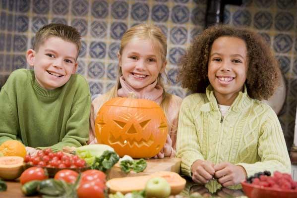 Children Cutting a Pumpkin