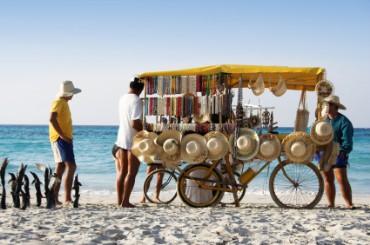 Beach Vendor Selling Souvenirs