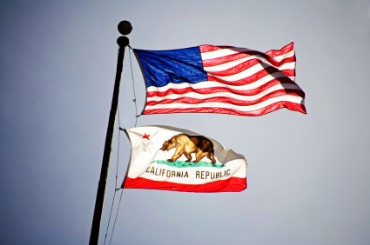 U.S. Flag Flying above California Flag