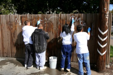 Community Volunteers Remove Grafitti