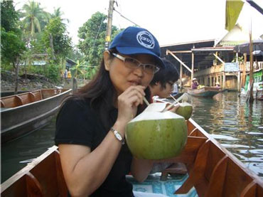 Woman Drinking Coconut Juice with a Straw
