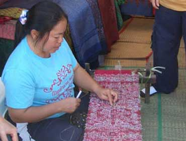 Woman Weaving a Pattern onto Silk